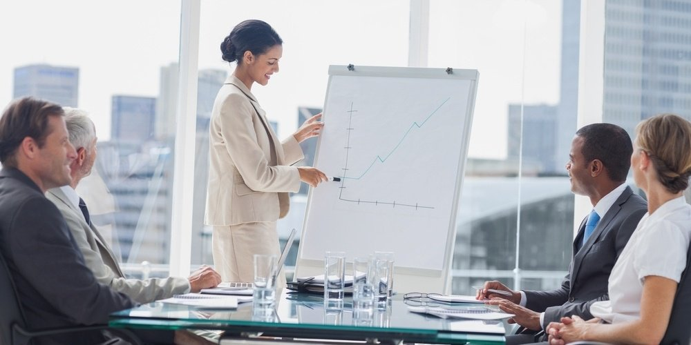 Businesswoman pointing at a growing chart during a meeting in the meeting room-138399-edited.jpeg