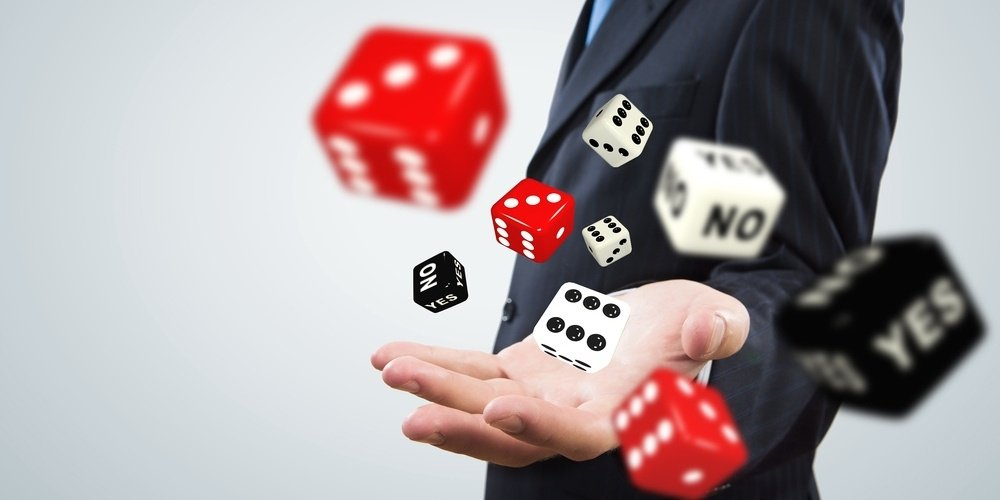 Close up of businessman throwing dice. Gambling concept-1-442750-edited.jpeg
