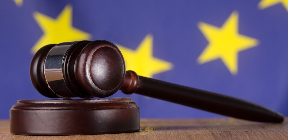Gavel resting on sound block with european union flag in background-498947-edited.jpeg