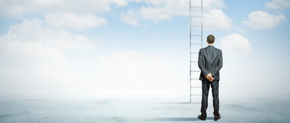 Rear view of businessman standing near ladder going high in sky-387790-edited.jpeg