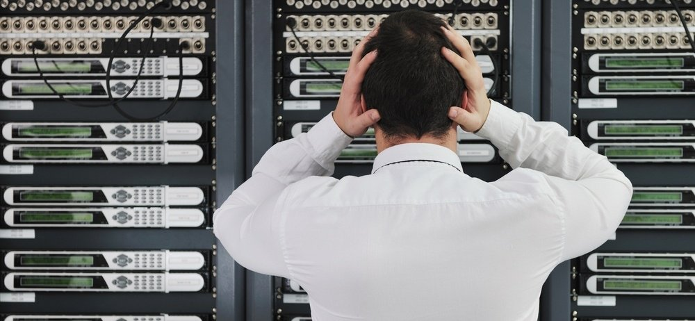 business man in network server room have problems and looking for disaster solution-250688-edited.jpeg